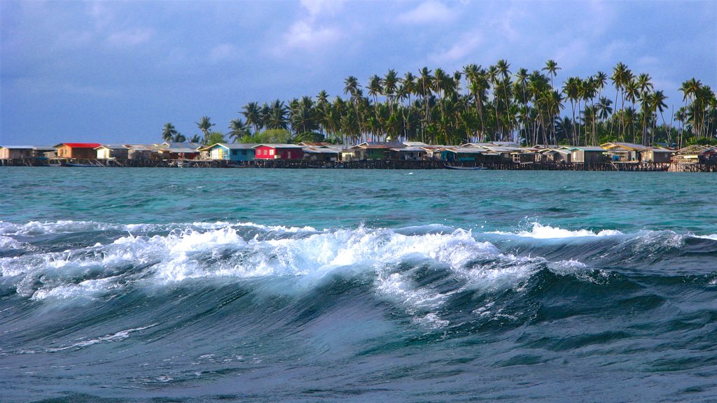 Mabul Island showing general coastal views and surf