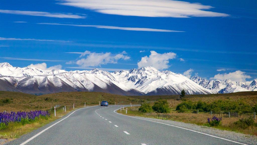 Lake Tekapo mostrando montañas, nieve y escenas tranquilas