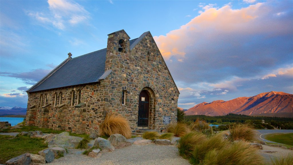 Church of the Good Shepherd showing a sunset, mountains and heritage elements