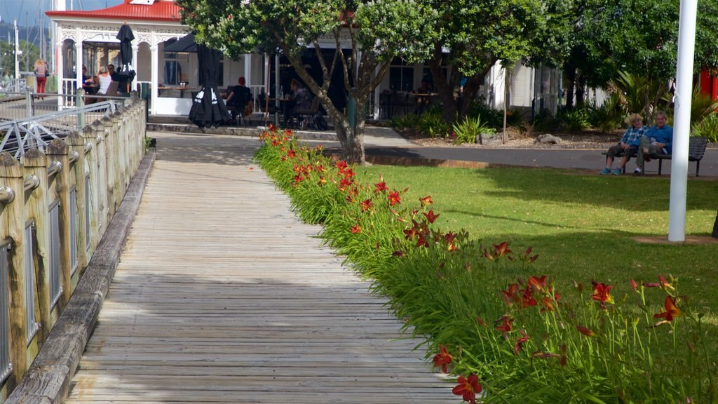 Town Basin Marina featuring a park and wildflowers as well as a couple