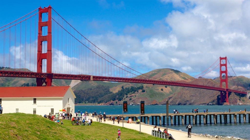 Golden Gate Bridge featuring a river or creek, a park and a bridge