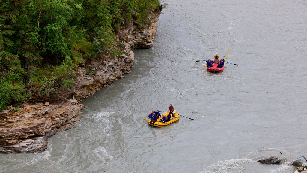 Denali which includes kayaking or canoeing and a river or creek as well as a small group of people
