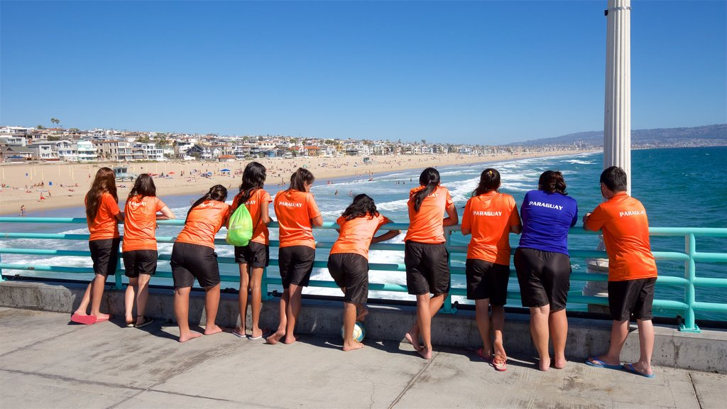 Manhattan Beach featuring general coastal views as well as a small group of people