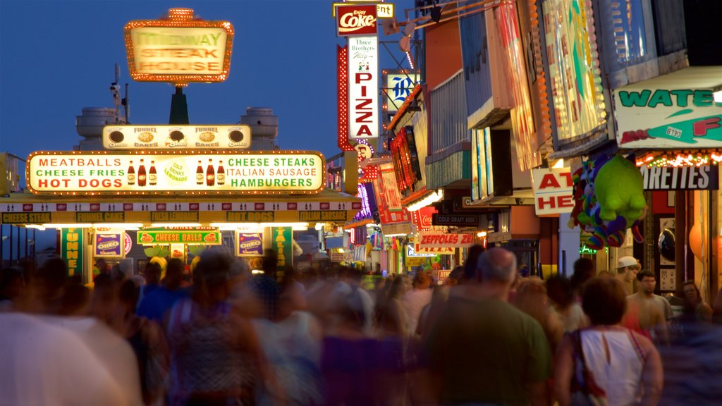 Seaside Heights featuring night scenes and signage as well as a large group of people