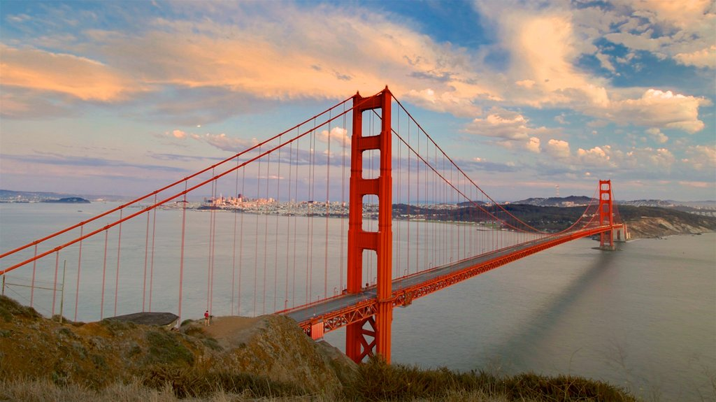 Golden Gate Bridge which includes a bridge, a sunset and a river or creek