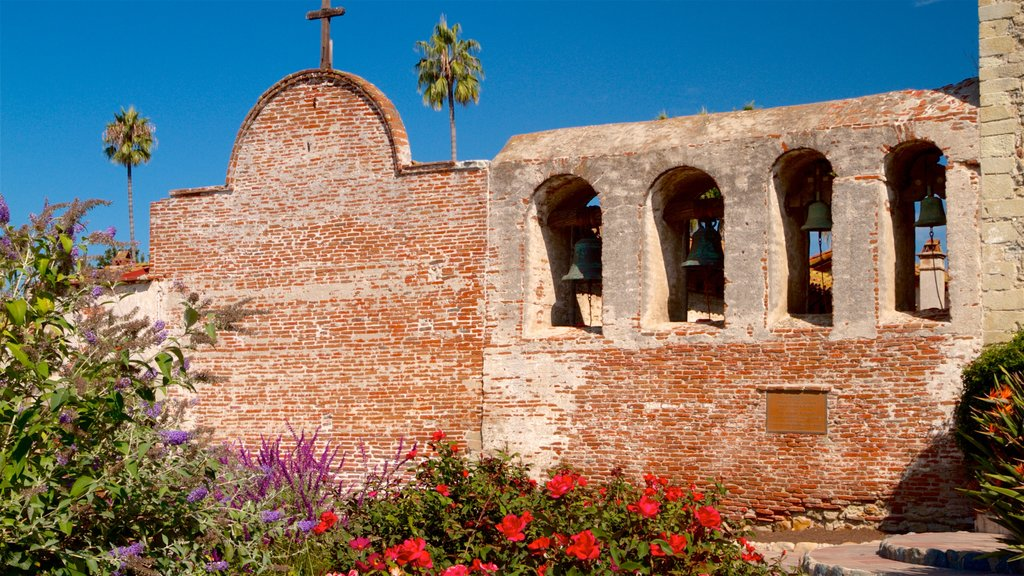 Mission San Juan Capistrano which includes heritage elements and wildflowers