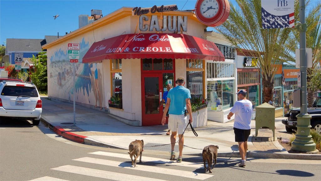 Hermosa Beach showing cuddly or friendly animals and signage as well as a couple