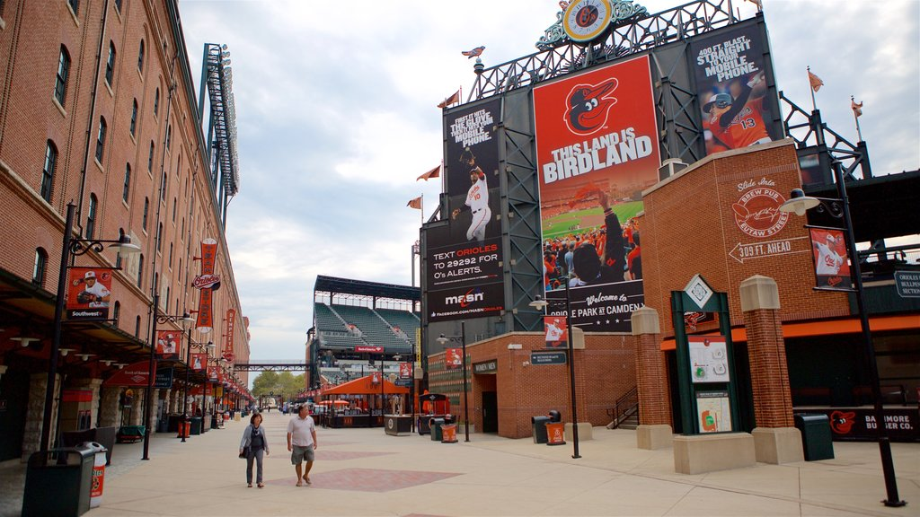 Oriole Park at Camden Yards showing signage as well as a couple