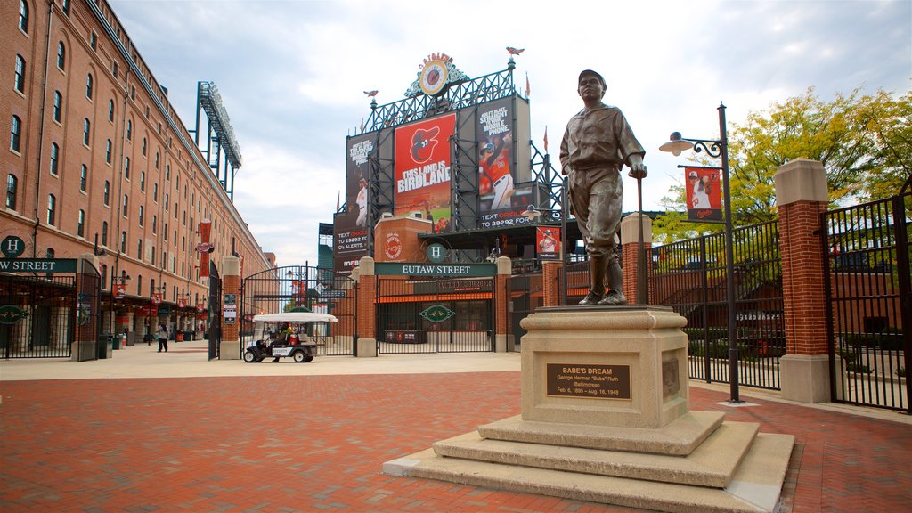 Oriole Park at Camden Yards showing signage and a statue or sculpture