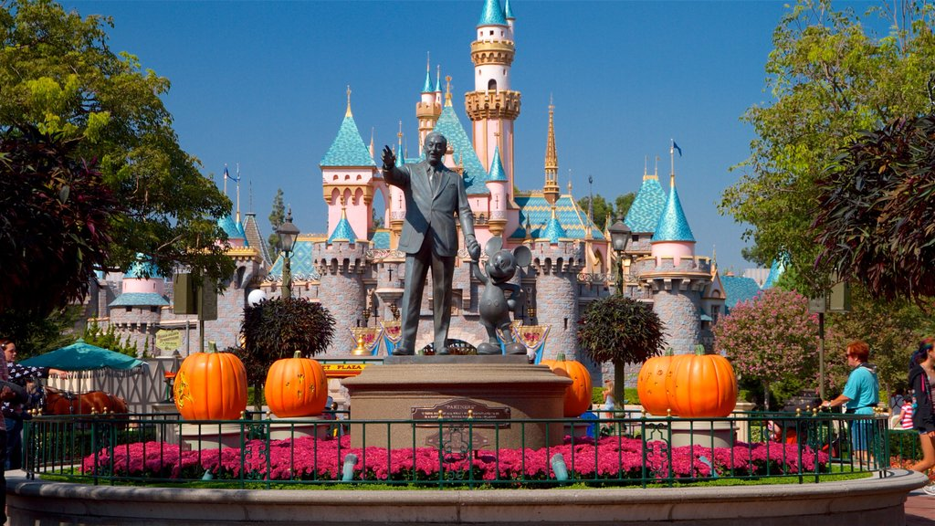 Disneyland® Park which includes rides, flowers and a statue or sculpture