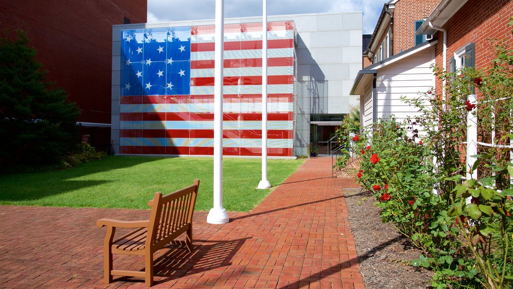 Flag House and Star-Spangled Banner Museum showing outdoor art, a garden and flowers