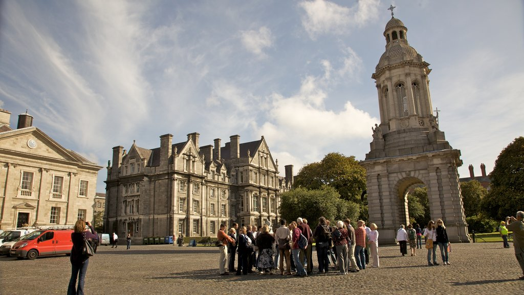 Trinity College which includes heritage architecture and a square or plaza as well as a large group of people