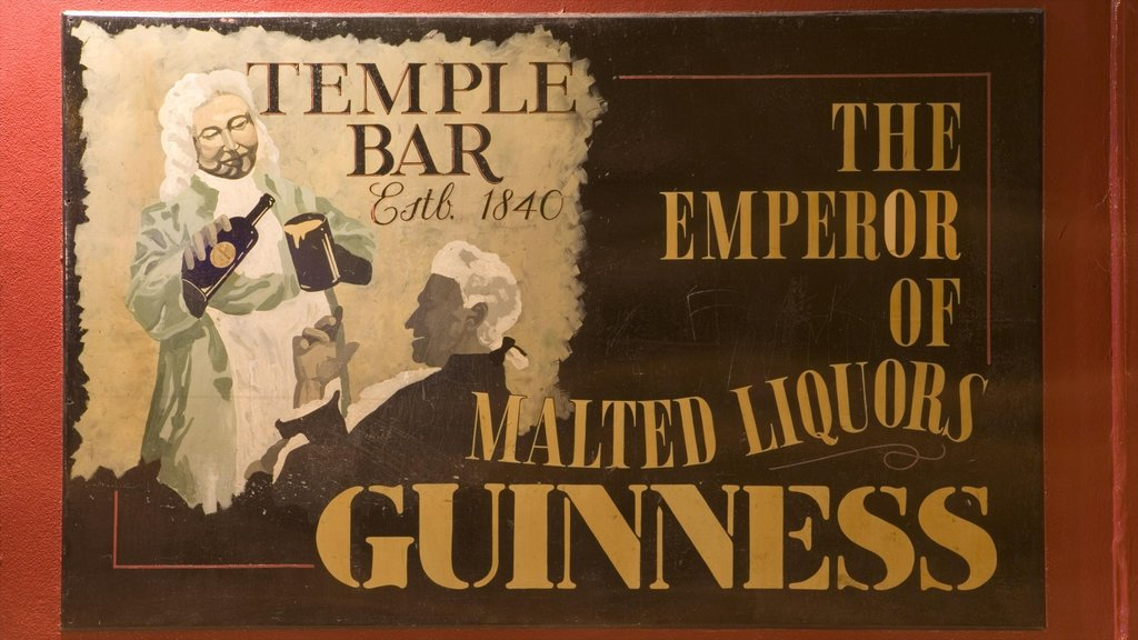 Temple Bar which includes signage, a bar and art