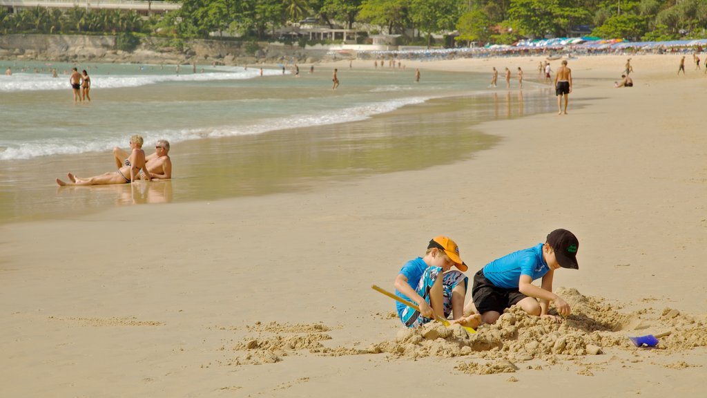 Nai Harn Beach showing swimming, tropical scenes and a sandy beach