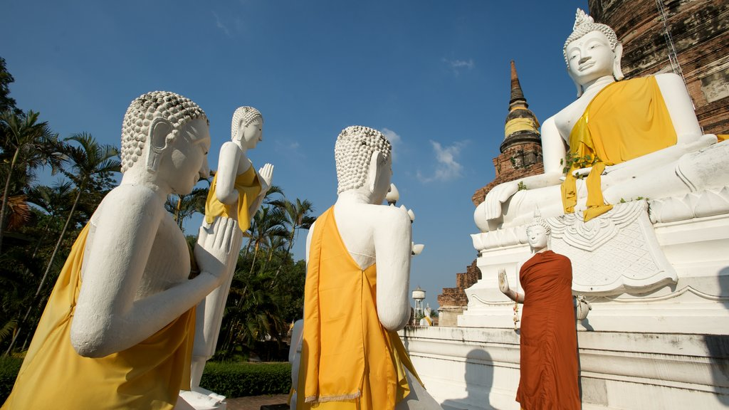 Ayutthaya which includes religious aspects, a statue or sculpture and a monument