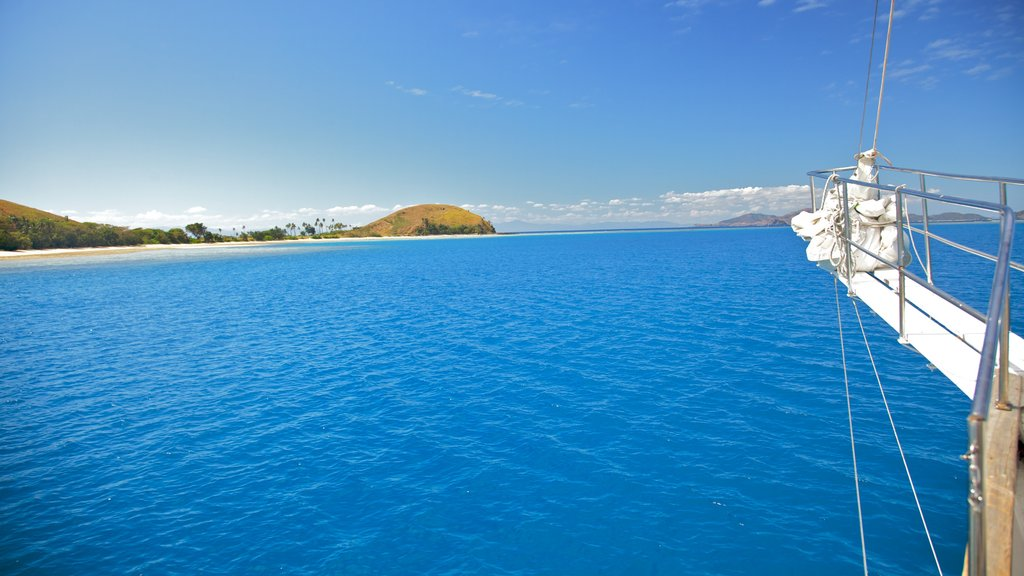 Mamanuca Islands which includes island images, boating and general coastal views
