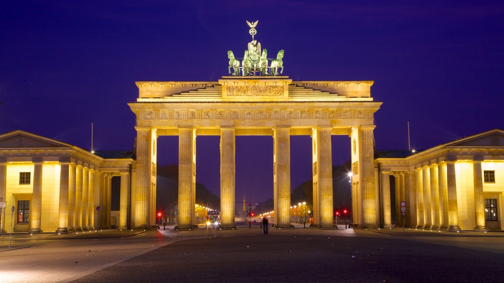Brandenburg Gate which includes a monument, a city and night scenes