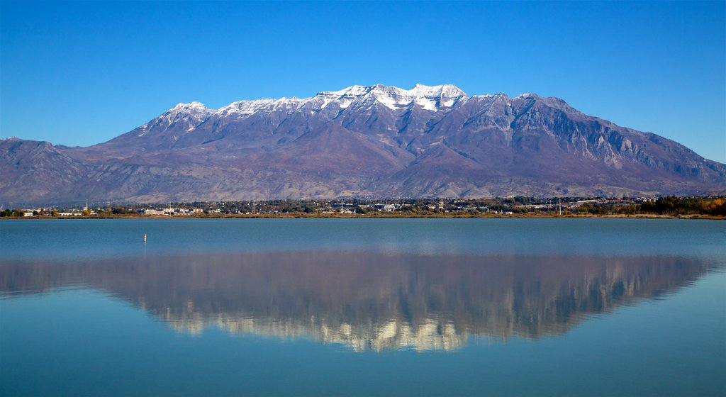 Utah Lake State Park which includes mountains and a lake or waterhole