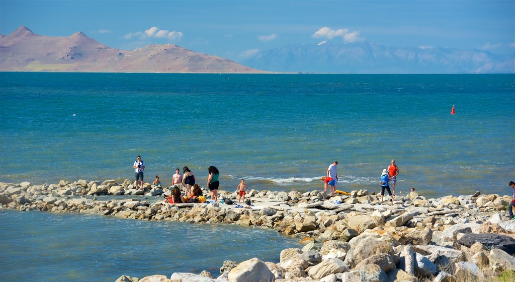 Great Salt Lake State Park featuring swimming, general coastal views and rocky coastline