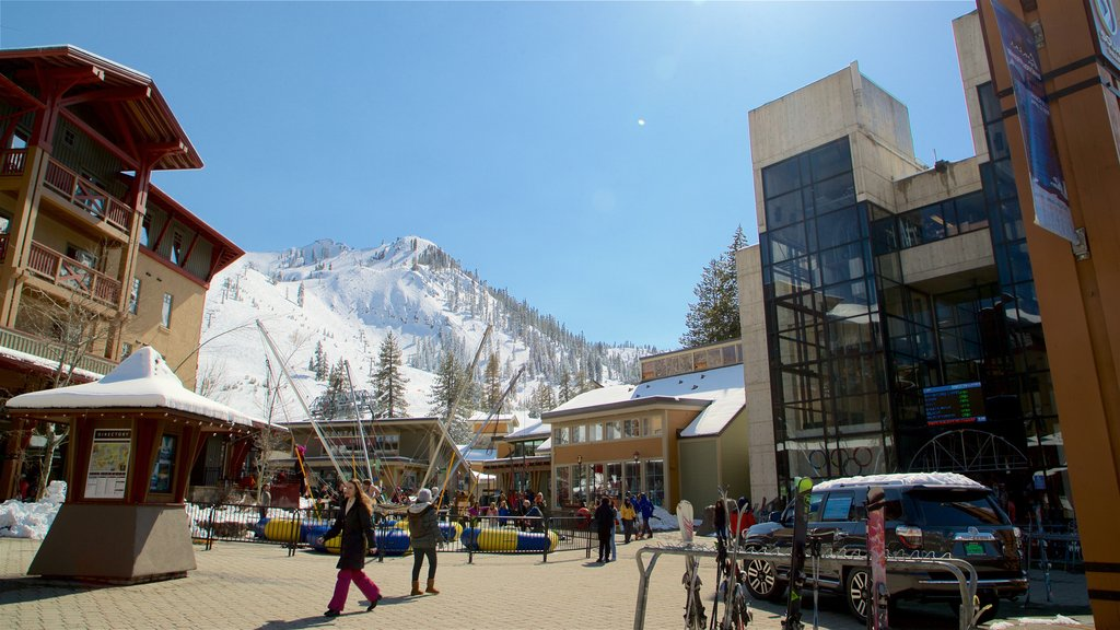 Olympic Valley showing a square or plaza, snow and mountains