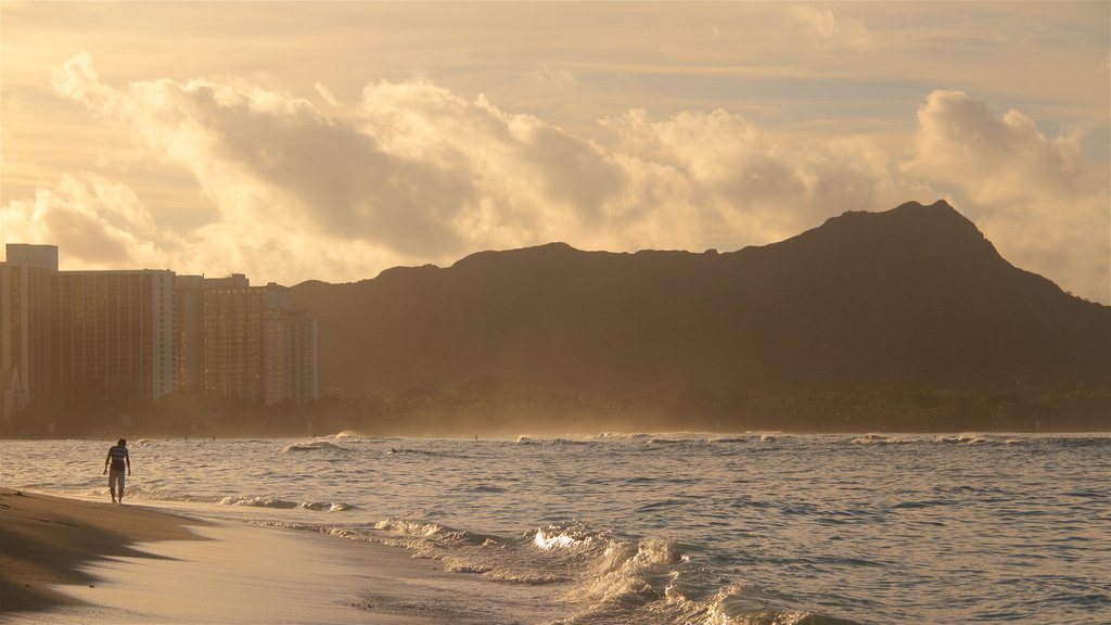Waikiki Beach featuring general coastal views, rocky coastline and a sunset