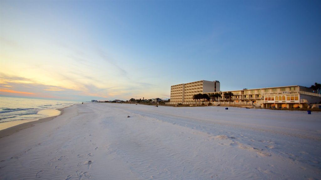 Panama City Beach featuring a sandy beach, a sunset and a coastal town
