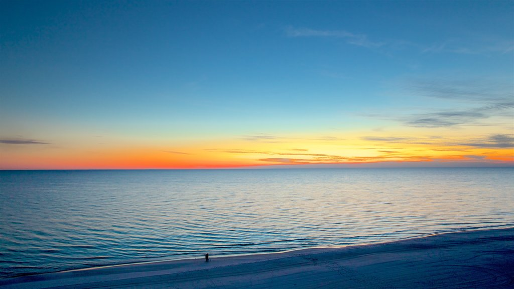 Panama City Beach which includes landscape views, a sunset and a sandy beach