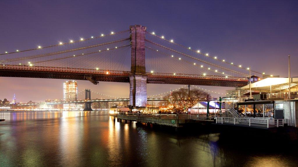 Brooklyn Bridge featuring a bridge, night scenes and a city