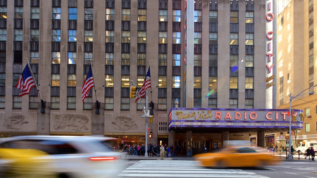 Radio City Music Hall featuring signage and a city