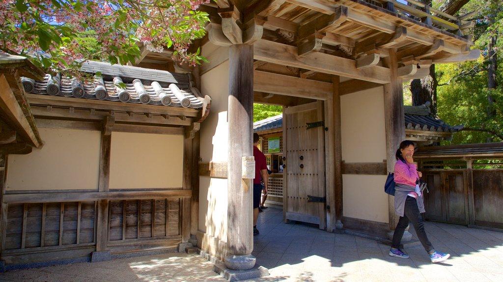 Japanese Tea Garden featuring a park as well as an individual femail