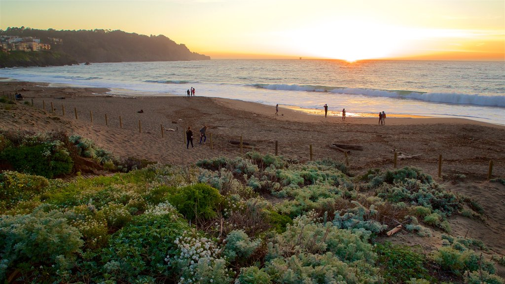 Baker Beach showing a sunset, general coastal views and waves