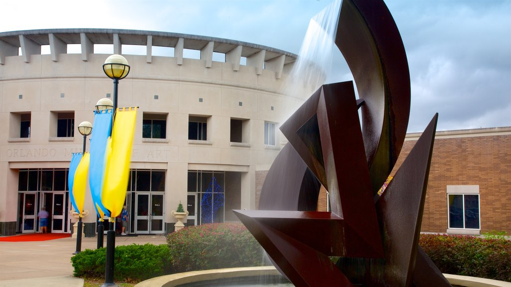Orlando Museum of Art featuring a fountain and outdoor art