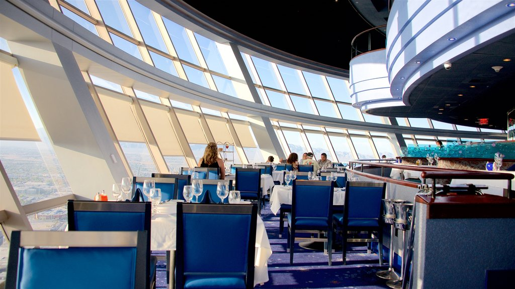 Stratosphere Tower showing dining out and interior views as well as a small group of people