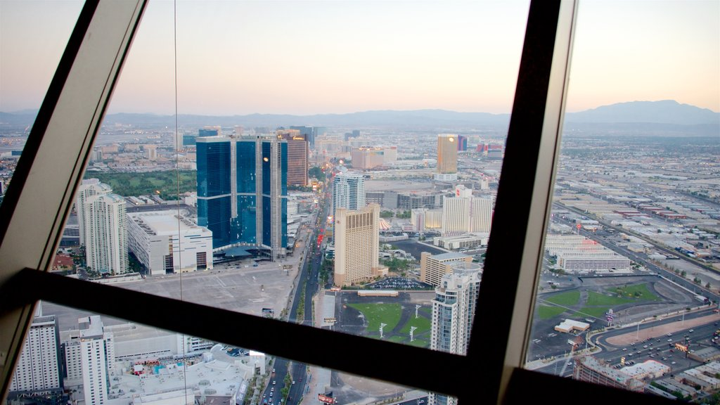 Stratosphere Tower showing a sunset, a high rise building and landscape views