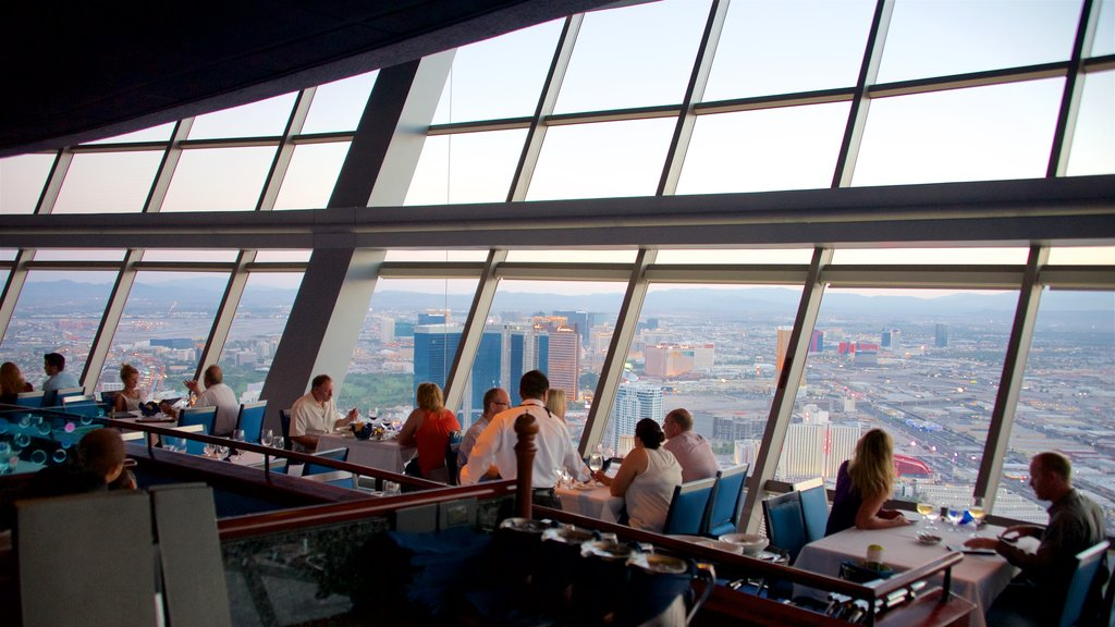 Stratosphere Tower featuring dining out, a city and interior views