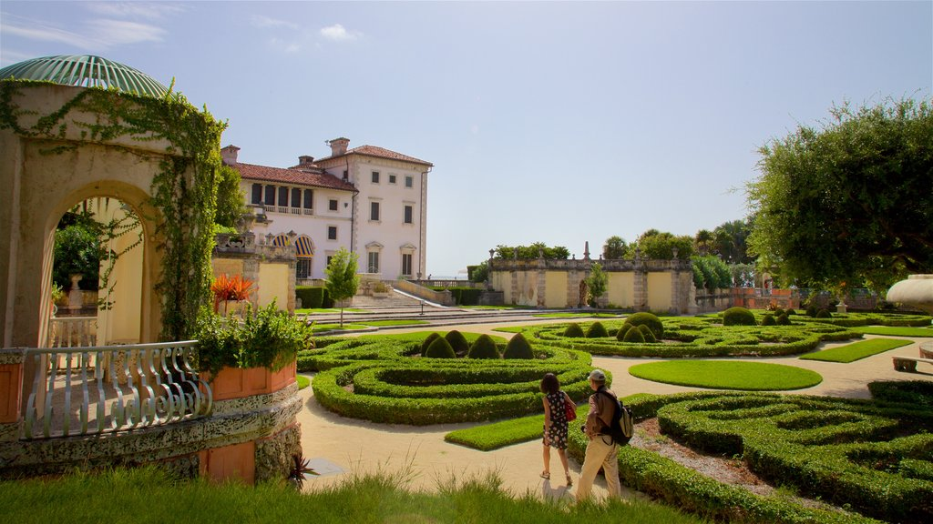 Vizcaya Museum and Gardens featuring a house and a park as well as a couple