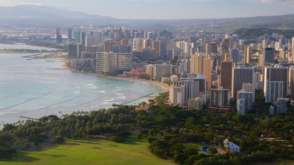 Diamond Head featuring a coastal town, a city and a sunset