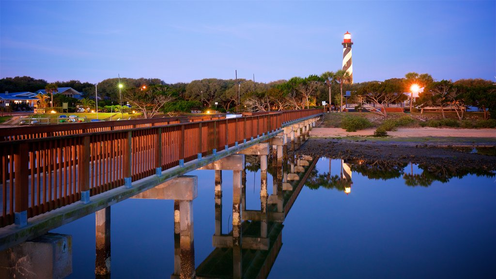 St. Augustine Lighthouse and Museum showing a lighthouse, a bridge and a sunset