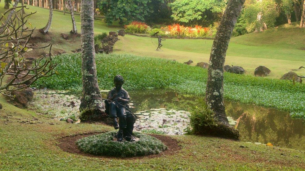 Na Aina Kai Botanical Gardens featuring a park, outdoor art and a pond