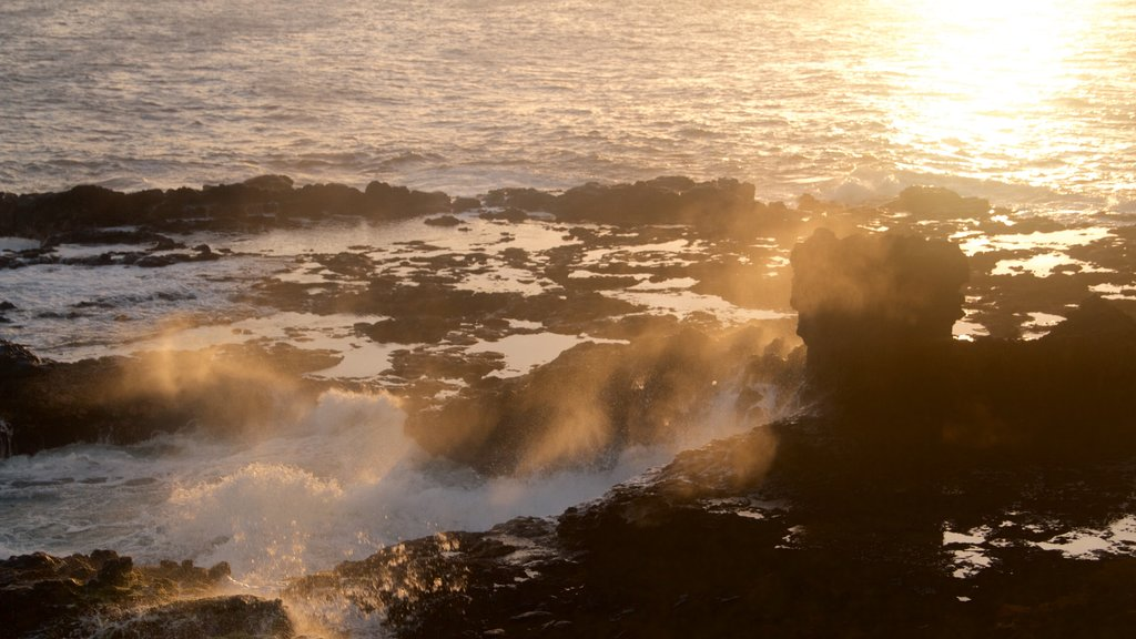 Spouting Horn which includes rocky coastline, a sunset and general coastal views