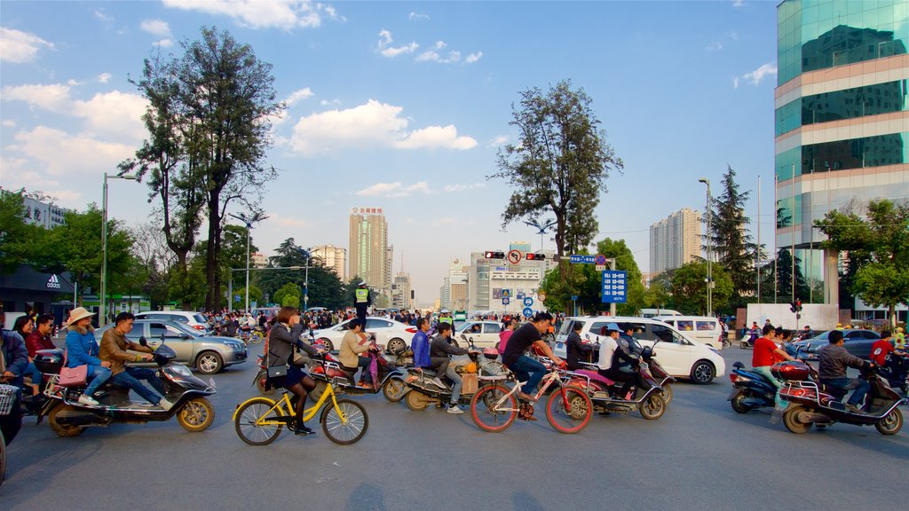 Kunming showing a sunset, a city and cycling