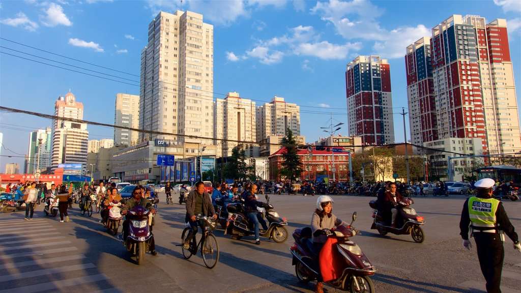 Kunming showing a city, a sunset and cycling