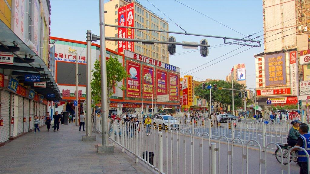 Tianhe que incluye una ciudad, señalización y una puesta de sol
