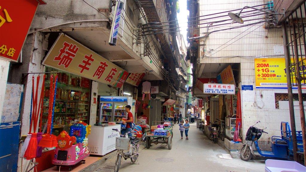 Tianhe que incluye señalización y una ciudad