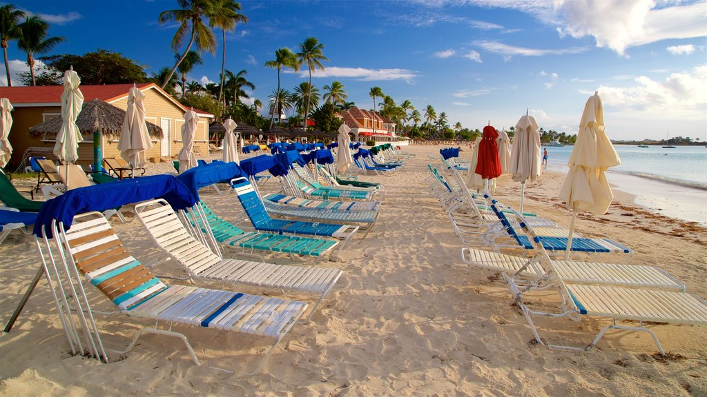 Dickenson Bay Beach featuring a sandy beach, tropical scenes and general coastal views