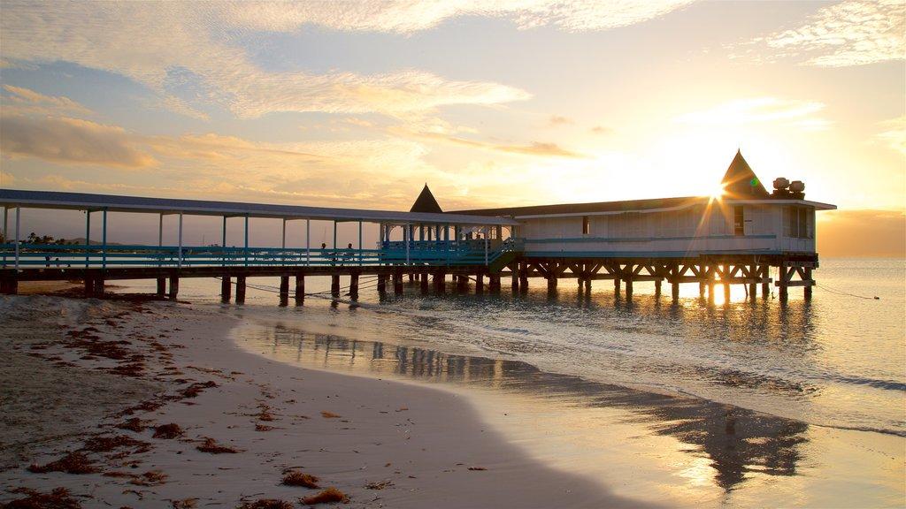 Dickenson Bay Beach featuring general coastal views, a beach and a sunset