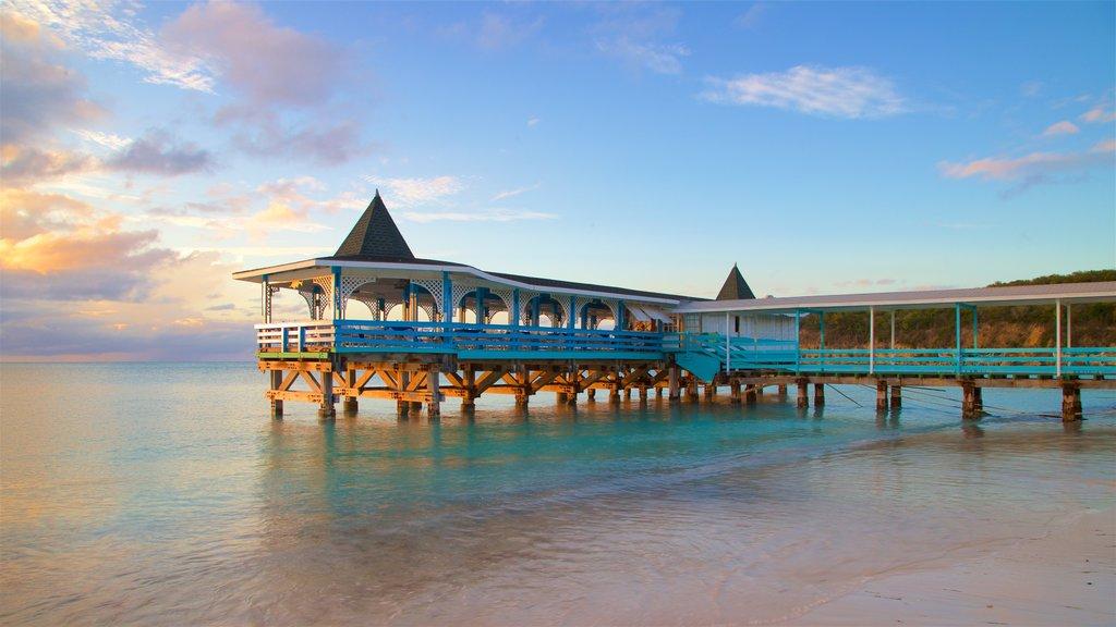 Dickenson Bay Beach showing general coastal views, a sunset and a beach