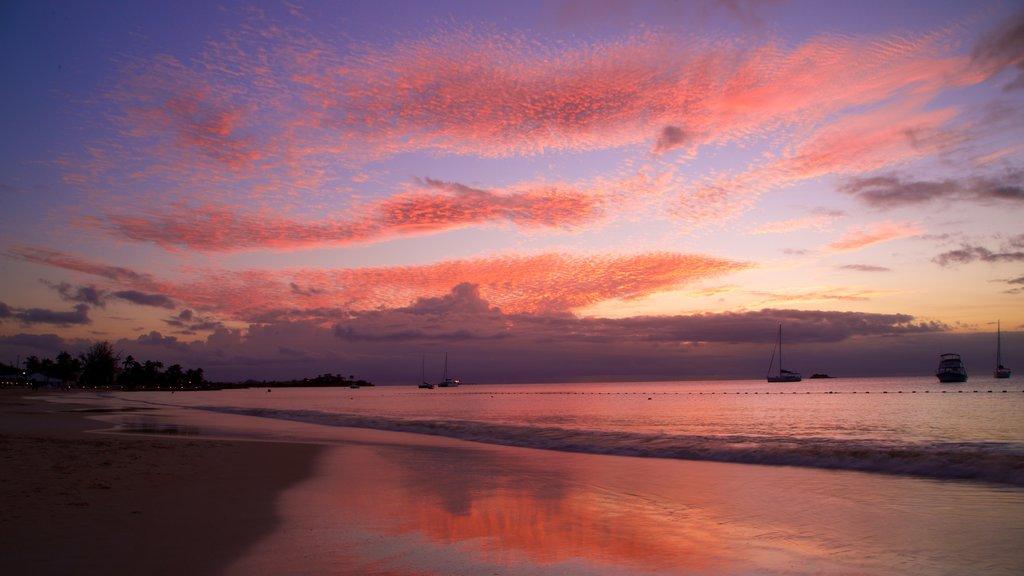 Dickenson Bay Beach showing a sunset, a sandy beach and general coastal views