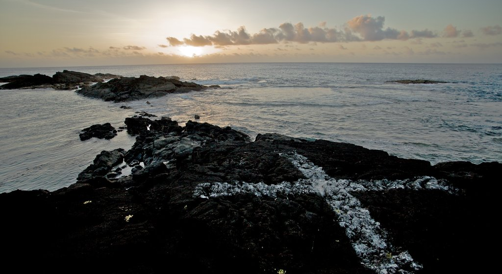 Samoa which includes a sunset, general coastal views and rugged coastline