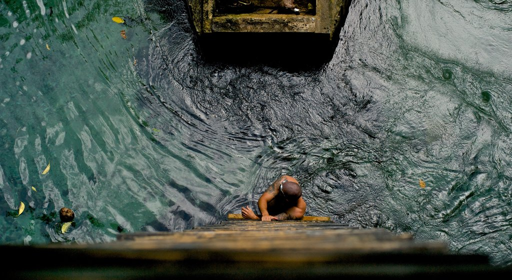 Samoa featuring swimming as well as an individual male